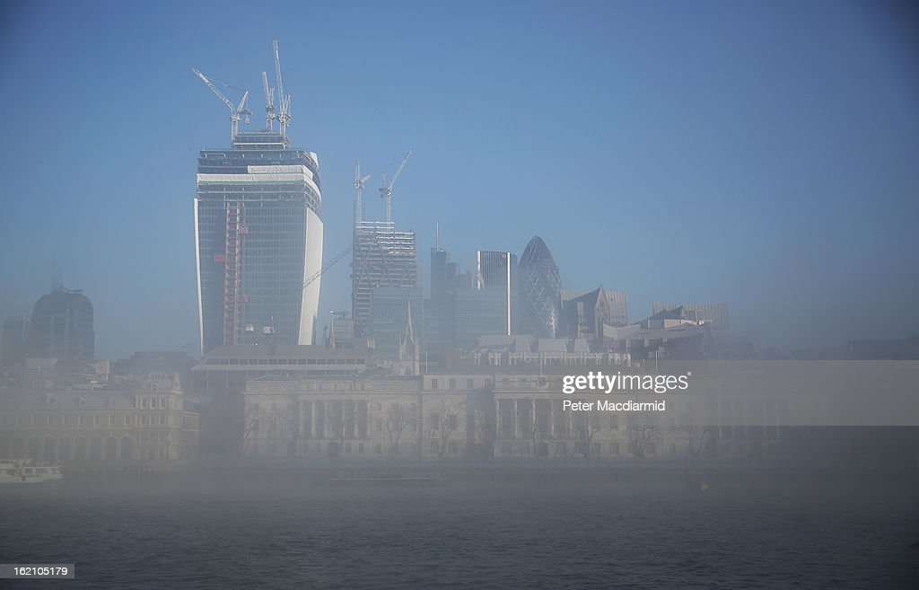 The City of London financial district emerges from early morning fog on The River Thames on February 19, 2013 in London, England. Heathrow was forced to cancel a number of flights and London City Airport suffered distruptions as a result of poor visibility due to fog.