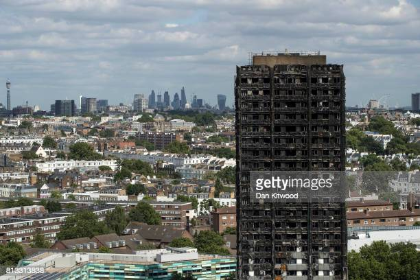The City of London skyline is seen behind the remains of Grenfell Tower on July 12 2017 in London England 80 people have been confirmed dead and...