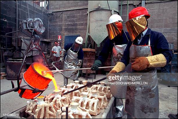 The city of master sculptors in Pietrasanta Italy in July 2001 Molten bronze casting at the Mariani foundry