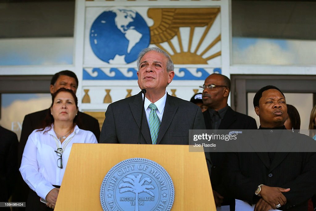 The City of Miami Mayor Tomas Regalado surrounded by members of the community and other officials speaks to the media about gun violence on January 14, 2013 in Miami, Florida. On the one month anniversary of the Newton, Connecticut school shooting area leaders came together to call on President Barack Obama and members of Congress to take immediate steps to end the gun violence epidemic.