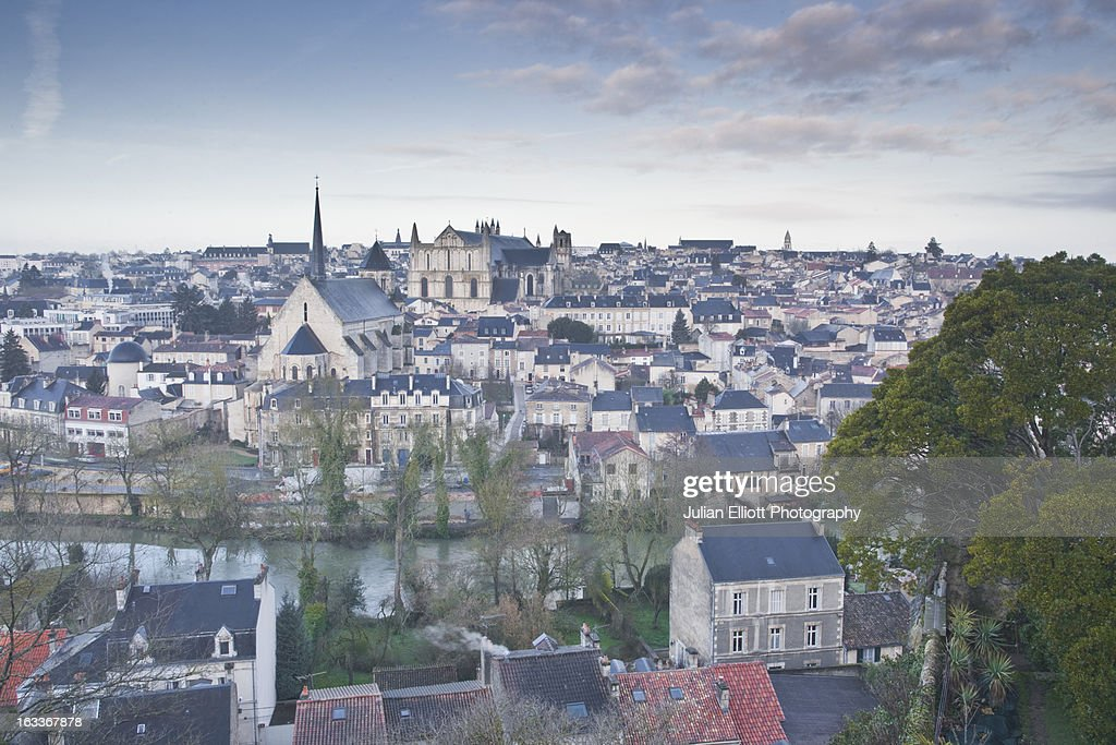 The city of Poitiers under dawn skies.
