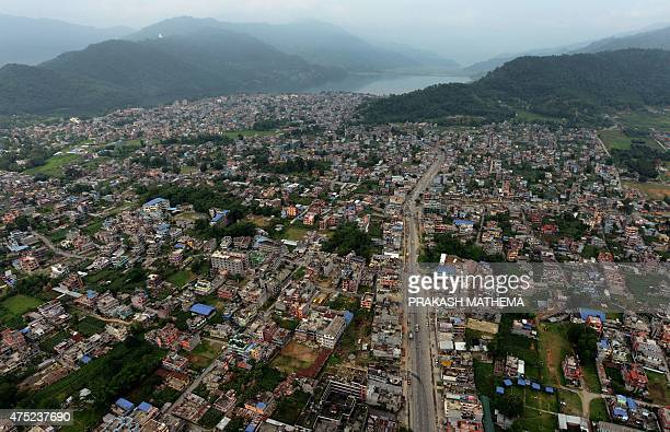 The city of Pokhara some 200 km west of Kathamndu is seen from an ultra light aircraft on May 30 2015 More than 8600 people died in the two...