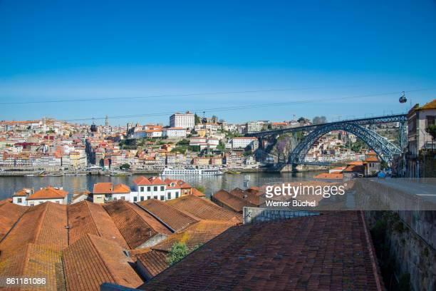 The city of Porto also called Oporto and its river Douro and the ridge Ponte Dom Luis I in Portugal on a sunny day in Spring time