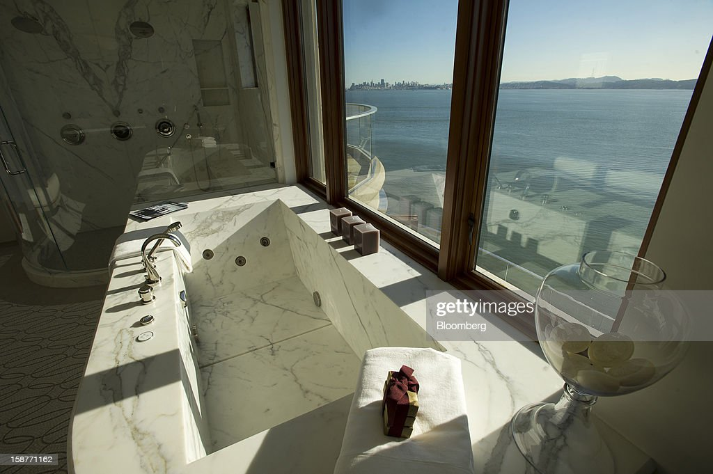 The city of San Francisco is seen in the view from the master bathroom of a 15,000 square-foot custom built home on Belvedere Island in Marin County, California, U.S., on Wednesday, Dec. 19, 2012. The builder couldn't find a buyer for the brand-new waterfront mansion he listed in January for $45 million. He hopes one will turn up at a Dec. 30 auction, where the starting bid will be $25 million. Photographer: David Paul Morris/Bloomberg via Getty Images