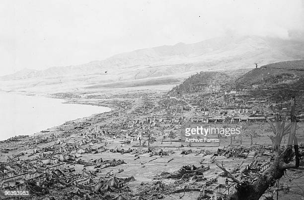 The city of St Pierre lies completely destroyed after the eruption of the Mount Pelee volcano in which 30000 people were killed and only 2 survived 2...