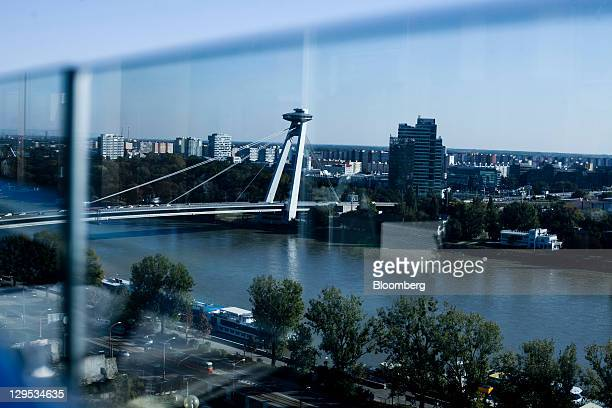The city skyline and Novy Most or New Bridge across the Danube river is seen from the parliament restaurant in Bratislava Slovakia on Monday Oct 17...