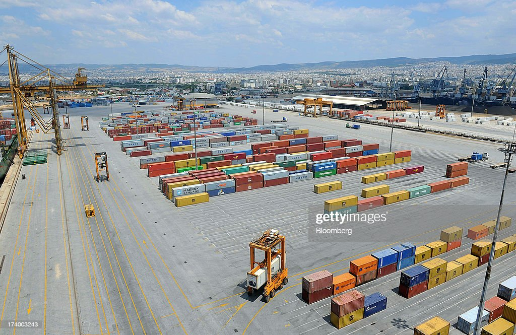 The city skyline stands beyond shipping containers on the dockside at Thessaloniki Port, operated by Thessaloniki Port Authority SA, in Thessaloniki, Greece, on Thursday, July 18, 2013. Russian Railways is interested in buying Thessaloniki Port and Greek rail operator Trainose SA as one single unit, newspaper Real News reported, citing an interview with the Russian company's CEO Vladimir Yakunin. Photographer: Oliver Bunic/Bloomberg via Getty Images