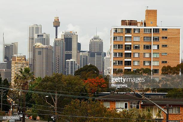 The city skyline stands in the background as residential buildings sit among trees in the suburb of Waverton in Sydney Australia on Saturday Oct 18...