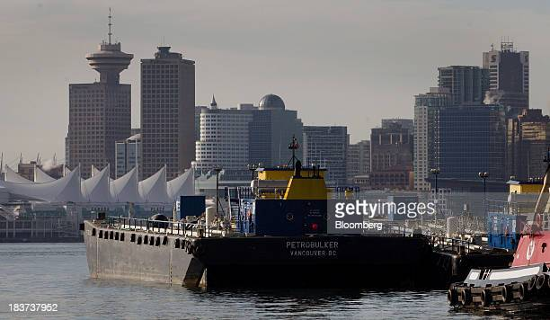 The city skyline stands in the distance as the Petrobulker vessel sits docked at the Seaspan Vancouver Shipyard in North Vancouver British Columbia...