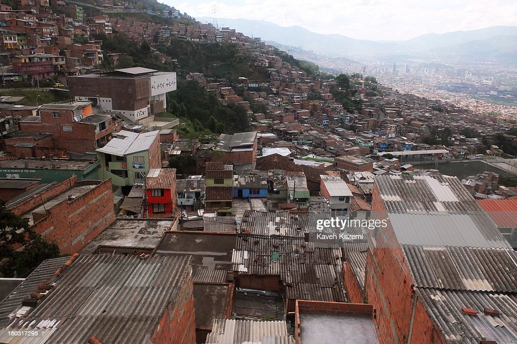 The city slums seen through the window of a cable car on January 5, 2013 in Medellin, Colombia. The notorious slums of Medellin have gone through urban and educational projects to improve the quality of life for its residence.