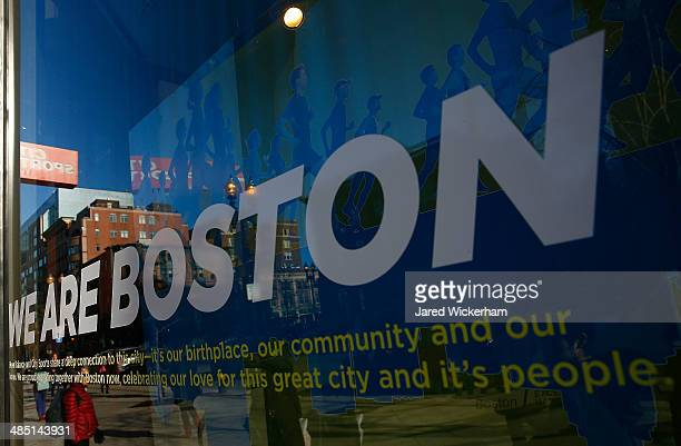The City Sports store window with the message 'We Are Boston' reflects the cityscape near the finish line of the Boston Marathon on April 16 2014 in...
