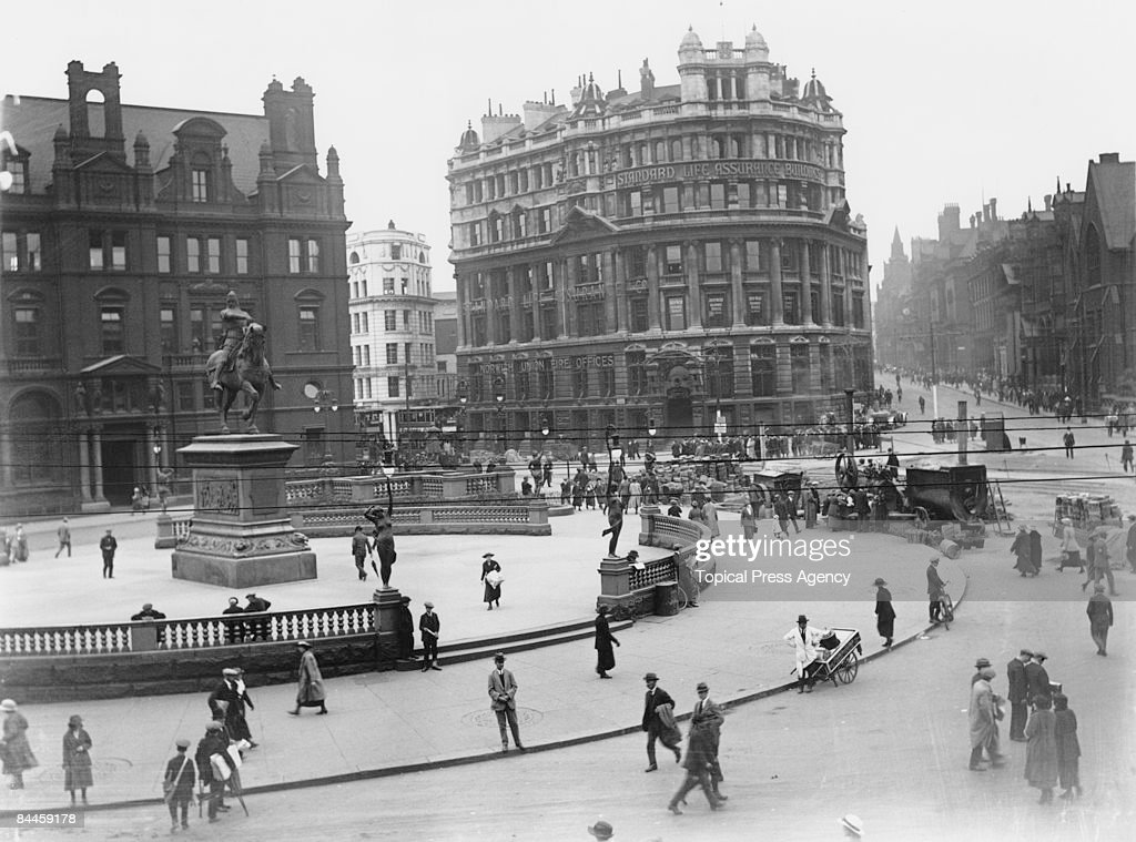 The City Square Leeds Yorkshire July 1921 A steam engine is being used by roadmenders at centreright