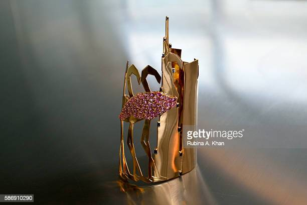 'The City The Birds' is a limited edition 18K gold hand cuff made by Lebanese born Dubaibased designer Nadine Kanso reflecting the contrasting...