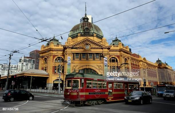 The City Tram runs outside Flinders Street Station in Melbourne Australia