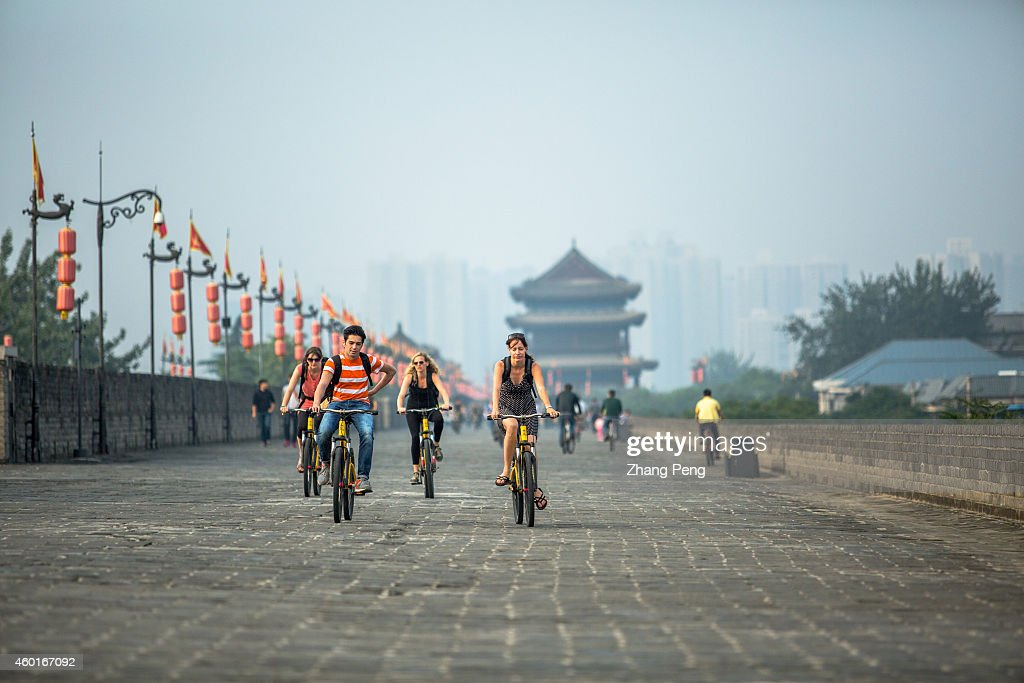 XI'AN SHAANXI PROVINCE CHINA The city wall surrounds the old city of Xian is 14km long and tourists can walk bike it or take a ride in an electric...