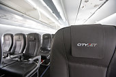 The CityJet Ltd logo hangs on a headrest on the seat of a Sukhoi Superjet 100 aircraft manufactured by Sukhoi Civil Aircraft Co on the opening day of...