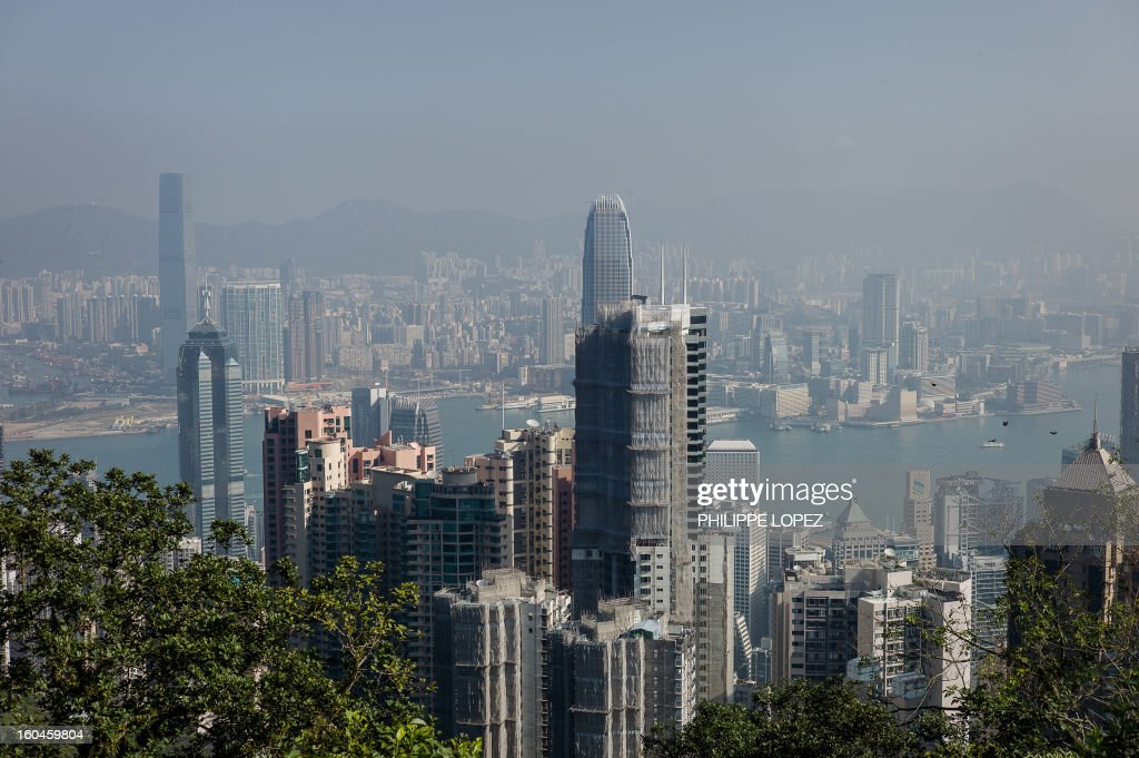 The city's skyline is seen over a thin haze of pollution on a clear day in Hong Kong on February 1, 2013. Emissions from factories in southern China, which seep over Hong Kong's border, combined with local emissions from power plants and transport, generate an almost daily thick blanket of haze over the teeming metropolis. AFP PHOTO / Philippe Lopez