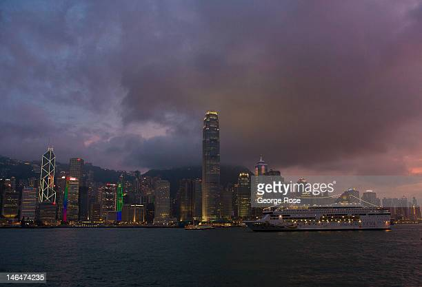 The city's skyline lights are turned on as the sun sets in the west on May 27 2012 in Hong Kong China Viewed as one of the world's major trade...
