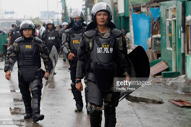 The civil service police unit walks at Kalijodo redlight district Bulldozers started demolishing hundreds of buildings in the Indonesian capital's...