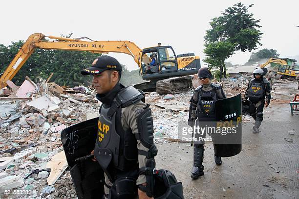 The civil service police unit walks near the ruins at Kalijodo redlight district Bulldozers started demolishing hundreds of buildings in the...
