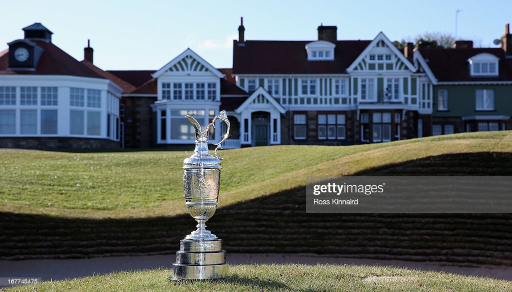 The Claret Jug trophy beside the 18th green in front of the clubhouse during The Open Championship media day at Muirfield on April 29, 2013 in Gullane, Scotland.