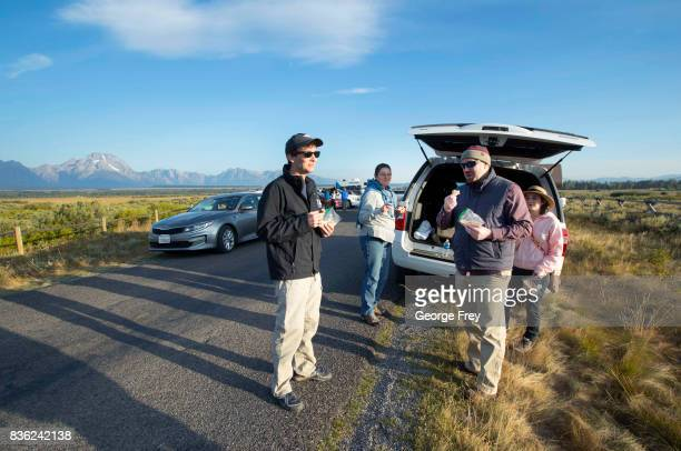 The Clark family from Shreveport Louisiana has breakfast as they wait for the total eclipse in Grand Teton National Park on August 21 2017 outside...