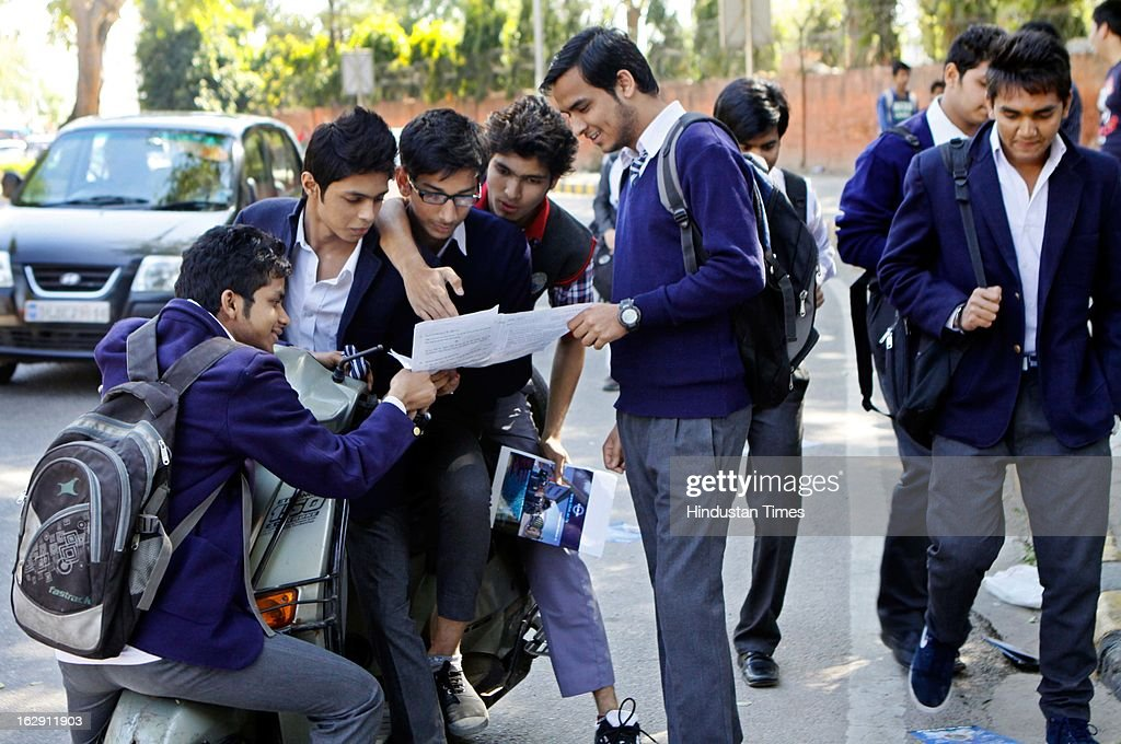 The class 12th students discuss the question paper after their first exam of English at their examination center at Gole Market on March 1, 2013 in New Delhi, India. Over all 22 lakh students are appearing for their CBSE exam for Class X and XII this year.