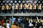 The Class of 2015 pose with their busts and presenters on stage during the NFL Hall of Fame induction ceremony at Tom Benson Hall of Fame Stadium on...