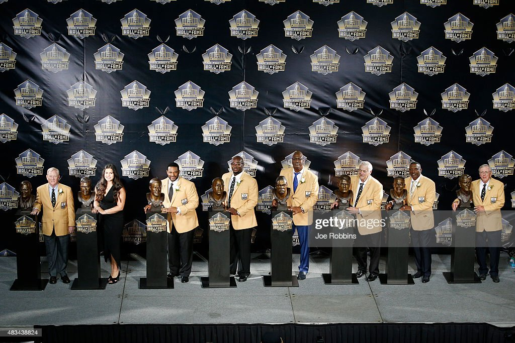 The Class of 2015 pose with their busts on stage during the NFL Hall of Fame induction ceremony at Tom Benson Hall of Fame Stadium on August 8 2015...