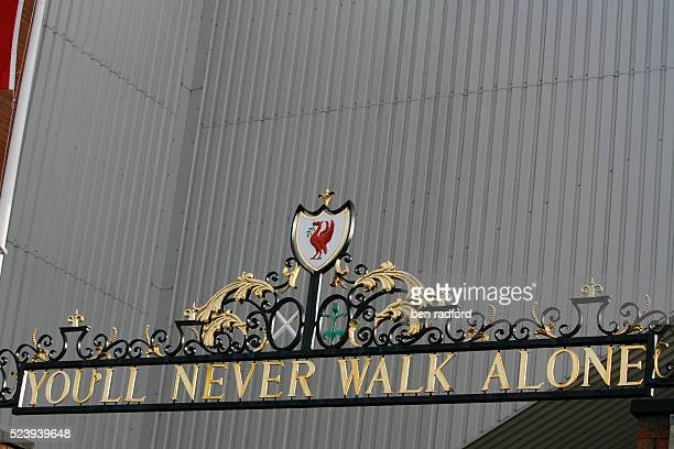 The classic Liverpool words You'll Never Walk Alone above the main gates of Anfield before the Europa Cup Quarter Final 2nd Leg match between...