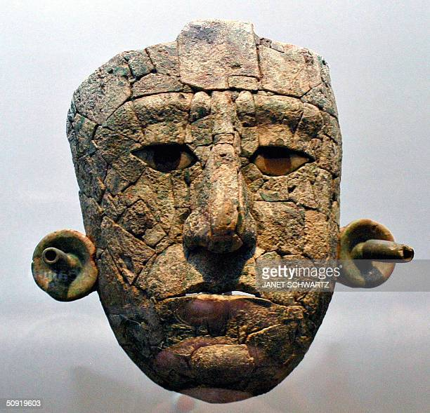 The Classic Maya mask of the Red Queen reconstructed from some 220 mosaic pieces found principally of malachite with jade and obsidian inlay in her...