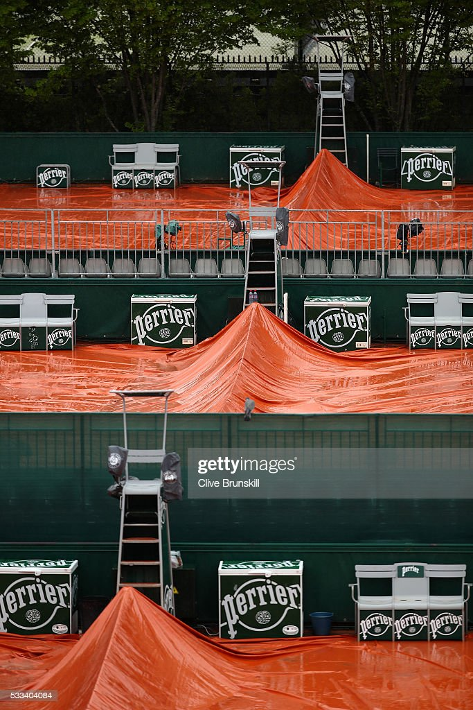 The clay courts are covered as rain delays play on day one of the 2016 French Open at Roland Garros on May 22 2016 in Paris France