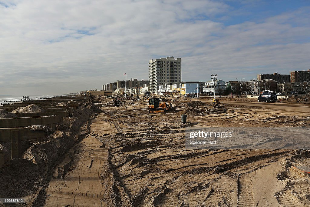 The clean up continues in the heavily damaged Rockaway neighborhood where a large section of the iconic boardwalk was washed away on November 14, 2012 in the Queens borough of New York City. Two weeks after Superstorm Sandy slammed into parts of New York and New Jersey, thousands are still without power and heat.