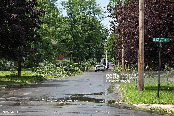 The clean up process continues a day after a severe summer storm downed trees and power lines in East Syracuse NY on July 8 2014 leaving the village...