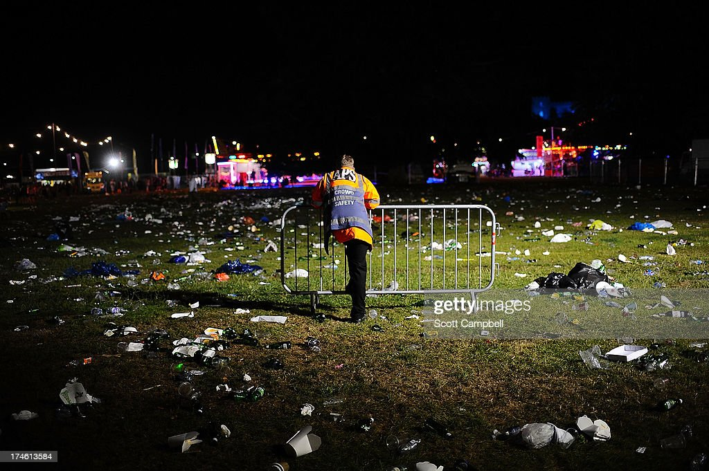 The cleanup begins as litter is strewn across the main arena at the end of Day 2 of Rewind 80s Festival 2013 at Scone Palace on July 27, 2013 in Perth, Scotland.