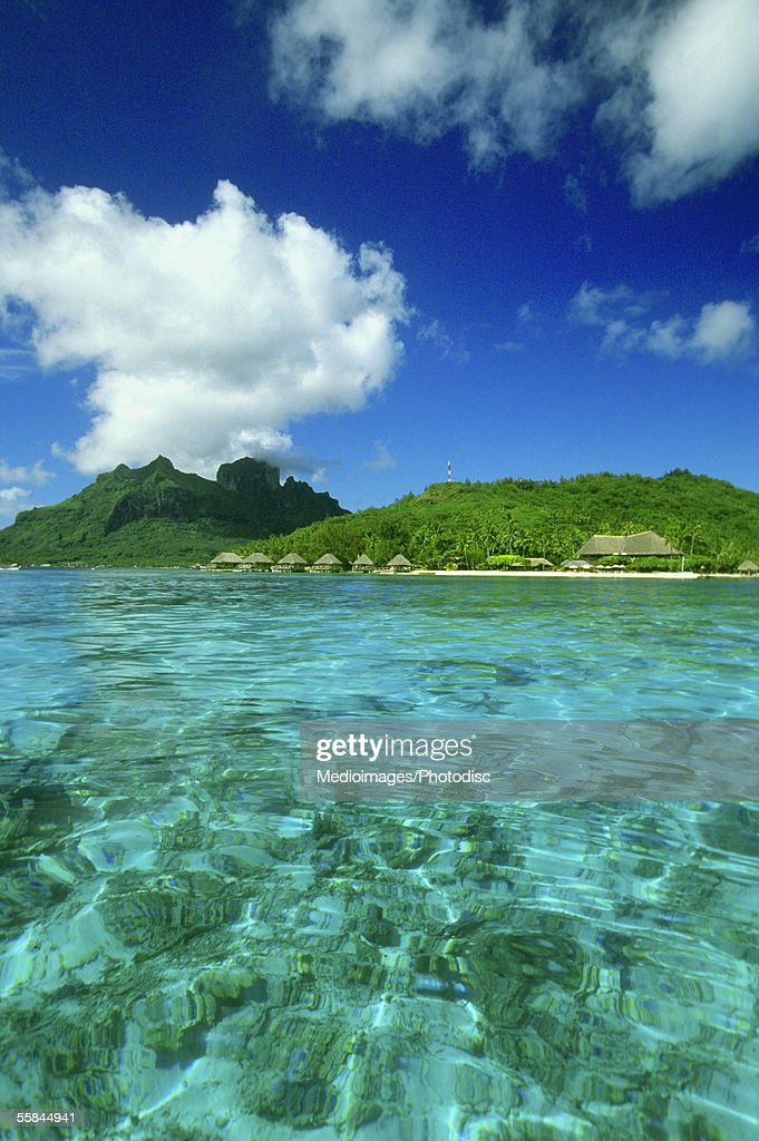 The clear South Pacific Ocean with bungalows, Bora Bora, French Polynesia : Stock Photo