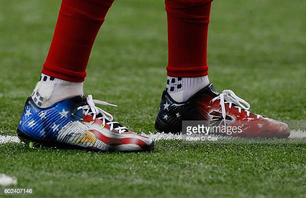 The cleats worn by Mohamed Sanu of the Atlanta Falcons are seen on the field during pregame warmups prior to facing the Tampa Bay Buccaneers at...