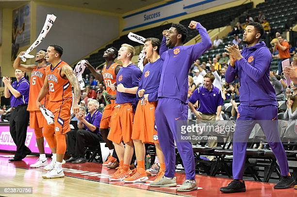 The Clemson bench celebrate a andone during an NCAA basketball game between the Davidson Wildcats and the Clemson Tigers on November 17 at HP Field...