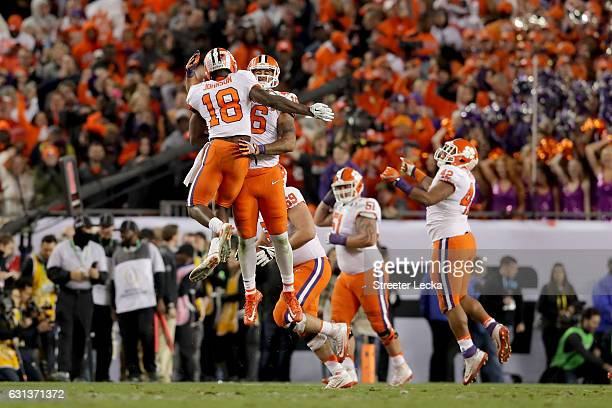 The Clemson Tigers celebrate after quarterback Deshaun Watson threw a 2yard gamewinning touchdown pass to wide receiver Hunter Renfrow during the...