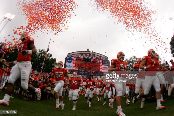 The Clemson Tigers run onto the field before the start of their game against the University of North Carolina Tar Heels on September 23 2006 at...