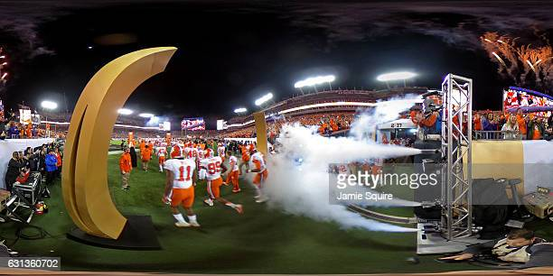 The Clemson Tigers run onto the field prior to the 2017 College Football Playoff National Championship Game against the Alabama Crimson Tide at...