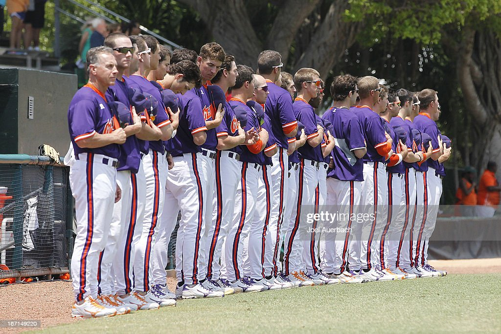 The Clemson Tigers stand during a moment of silence for the victims of the Boston Marathon Bombing and the national anthem prior to the game against the Miami Hurricanes on April 21, 2013 at Alex Rodriguez Park at Mark Light Field in Coral Gables, Florida. Miami defeated Clemson 7-0.