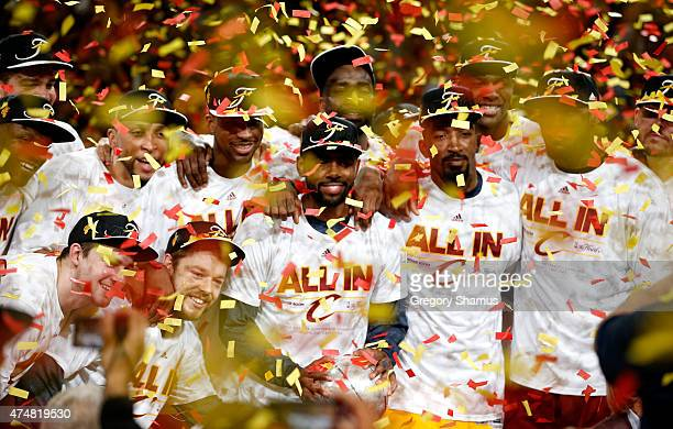 The Cleveland Cavaliers celebrate after defeating the Atlanta Hawks during Game Four of the Eastern Conference Finals of the 2015 NBA Playoffs at...