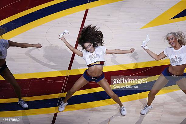 The Cleveland Cavaliers dance team performs in Game Three of the 2015 NBA Finals against the Golden State Warriors on June 9 2015 at Quicken Loans...
