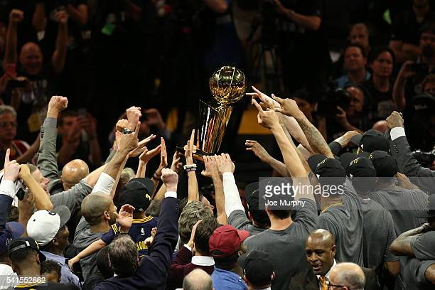 The Cleveland Cavaliers hold the Larry O'Brien NBA Championship Trophy up after winning against Golden State Warriors in Game Seven of the 2016 NBA...