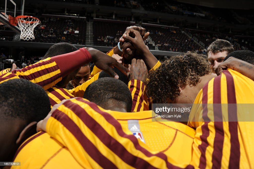 The Cleveland Cavaliers huddle up before the game against the Milwaukee Bucks at The Quicken Loans Arena on October 8, 2013 in Cleveland, Ohio.