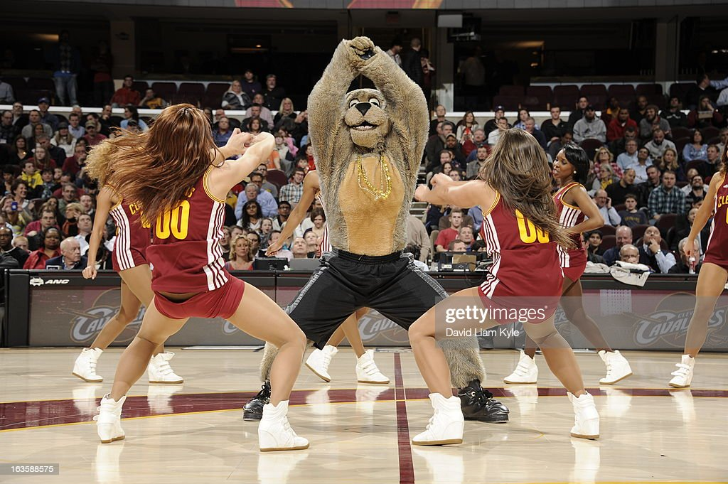The Cleveland Cavaliers mascot, 'Moondog,' and the dance team perform during a break in action against the Toronto Raptors at The Quicken Loans Arena on February 27, 2013 in Cleveland, Ohio.