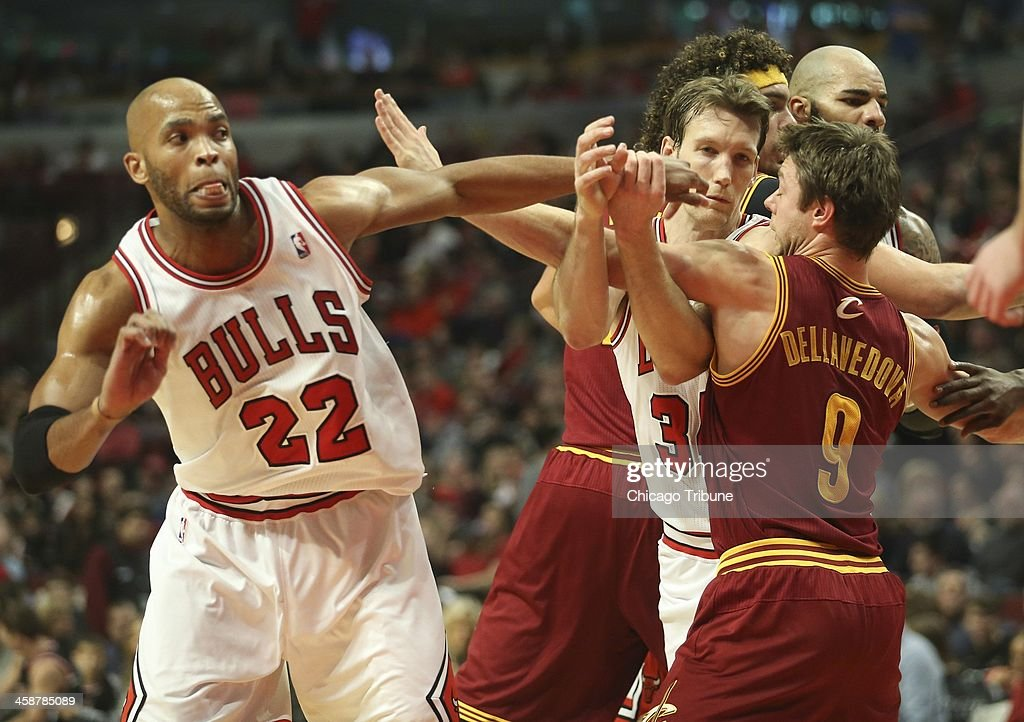 The Cleveland Cavaliers' Matthew Dellavedova (9) and the Chicago Bulls' Mike Dunleavy (34) jockey for position during the second half at the United Center in Chicago on Saturday, Dec. 21, 2013. The Bulls won, 100-84.