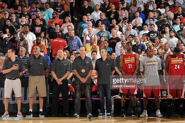 The Cleveland Cavaliers stand during the National Anthem before the game against the Milwaukee Bucks at the Samsung NBA Summer League 2014 on July 11...