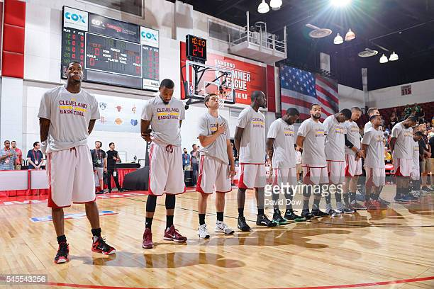 The Cleveland Cavaliers stand for the national anthem before the game against the Milwaukee Bucks during the 2016 NBA Las Vegas Summer League game on...